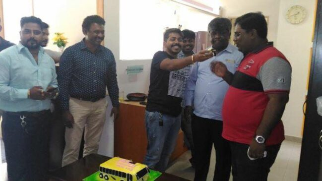 celebarating birth day in his office